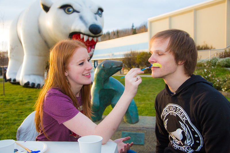 """Mari Freitag puts her painting skills to good use with Jordan Lichtenberger during festivities surrounding the Starvation Gulch celebration in front of the Patty Center.  <div class=""""ss-paypal-button"""">Filename: LIF-12-3570-099.jpg</div><div class=""""ss-paypal-button-end"""" style=""""""""></div>"""
