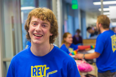 Returning students, staff and parents all pitch in to help new arrivals move into the residence halls during Rev It Up on the Fairbanks campus at the beginning of the fall 2015 semester.  Filename: LIF-15-4636-161.jpg