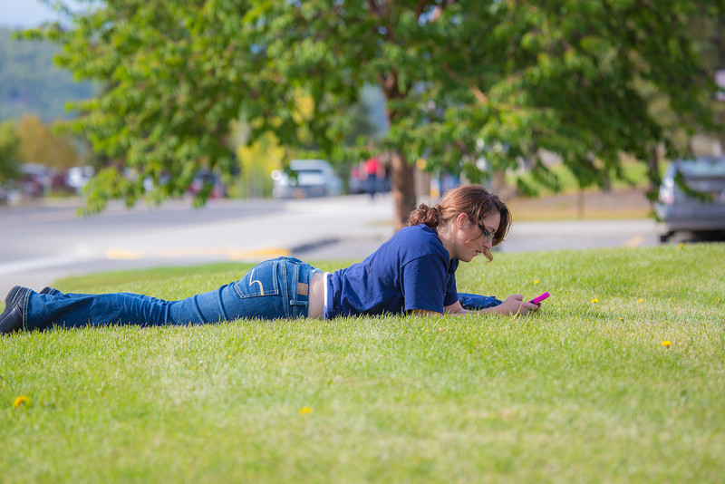 """Biology major Kayleen Hansen enjoys the nice weather on campus during the first day of classes for the fall semester.  <div class=""""ss-paypal-button"""">Filename: LIF-12-3529-074.jpg</div><div class=""""ss-paypal-button-end"""" style=""""""""></div>"""