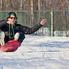 "Jimmy Donohue spends some quality time on the UAF sledding hill on a nice February afternoon.  <div class=""ss-paypal-button"">Filename: LIF-12-3290-01.jpg</div><div class=""ss-paypal-button-end"" style=""""></div>"
