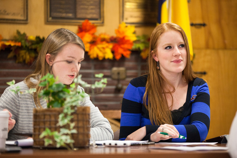 """ASUAF Mari Freitag, right, listens to the role call from ASUAF Chair Ayla O'Scannell during the student government at their weekly meeting at the Alumni Lounge in October.  <div class=""""ss-paypal-button"""">Filename: LIF-12-3582-2.jpg</div><div class=""""ss-paypal-button-end"""" style=""""""""></div>"""