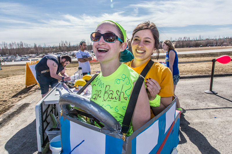 """Kaitlin Lault and Bess Jacobson clown around the Moore Hall car bash during UAF SpringFest April 28.  <div class=""""ss-paypal-button"""">Filename: LIF-14-4168-61.jpg</div><div class=""""ss-paypal-button-end""""></div>"""