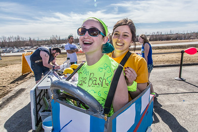 Kaitlin Lault and Bess Jacobson clown around the Moore Hall car bash during UAF SpringFest April 28.  Filename: LIF-14-4168-61.jpg