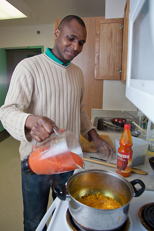Peter Ikewun, a petroleum engineeering graduate student from Nigeria, prepares a traditional African soup in his communal Wickersham Hall kitchen.  Filename: LIF-12-3268-093.jpg