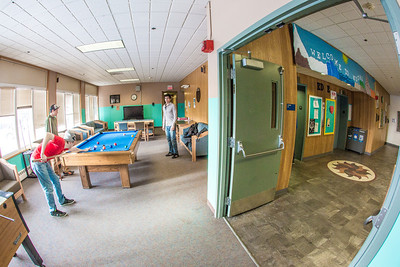 Residents of Moore Hall spend some free time at the pool table in the lounge on a winter afternoon.  Filename: LIF-13-3735-207.jpg