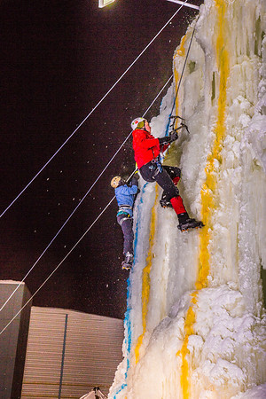 Climbers race to the top of the tower during the ice climbing competition, offered as part of the 2014 UAF Winter Carnival.  Filename: LIF-14-4084-94.jpg