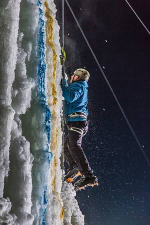A climber approaches the top of the tower during the ice climbing competition, offered as part of the 2014 UAF Winter Carnival.  Filename: LIF-14-4084-80.jpg