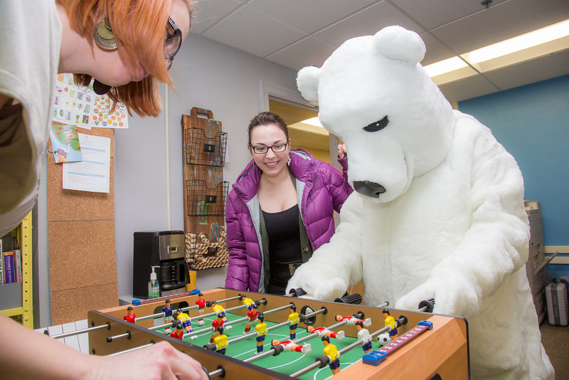 """The UAF mascot enjoys a game of foosball with colleagues in an Eielson Building office.  <div class=""""ss-paypal-button"""">Filename: LIF-14-4101-7.jpg</div><div class=""""ss-paypal-button-end"""" style=""""""""></div>"""