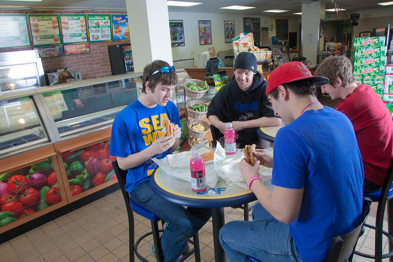 """Students Quinn Verfaillie, left, and Robert Doerning enjoy sandwiches in the Campus Cache, located in the Moore-Bartlett-Skarland residence hall complex on the Fairbanks campus.  <div class=""""ss-paypal-button"""">Filename: LIF-12-3339-26.jpg</div><div class=""""ss-paypal-button-end"""" style=""""""""></div>"""