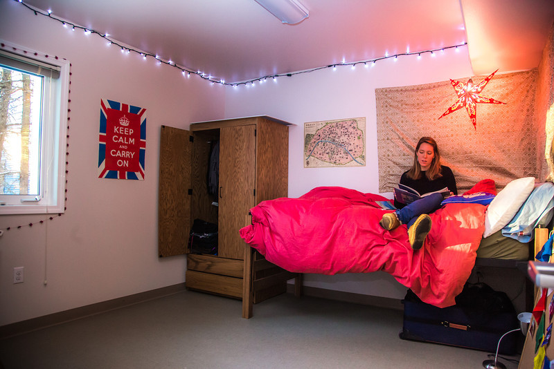 "Northern Studies graduate student Emily Russell reads inside her bedroom in Birch House, one of four units in UAF's Sustainable Village.  <div class=""ss-paypal-button"">Filename: LIF-12-3632-169.jpg</div><div class=""ss-paypal-button-end"" style=""""></div>"