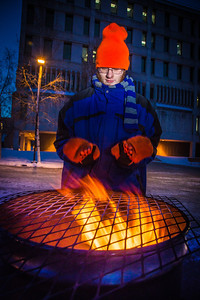 Mathew Carrick take his turn at the Honors Program homeless vigil Friday morning while the temperature hovered around -20°.  Filename: LIF-12-3653-33.jpg