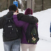 "Students walk arm in arm across campus after a big snow fall.  <div class=""ss-paypal-button"">Filename: LIF-12-3319-41.jpg</div><div class=""ss-paypal-button-end"" style=""""></div>"