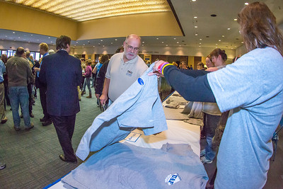 Staff members of UAF's Marketing and Communications office were on hand to give out free t-shirts to those attending the chancellor's annual convocation address in the Davis Concert Hall.  Filename: LIF-13-3945-108.jpg