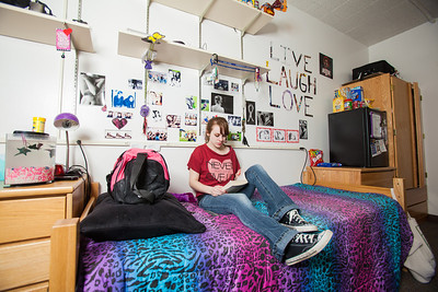 Freshman Hailley Myers reads a textbook in her room in Skarland Hall.  Filename: LIF-12-3322-176.jpg