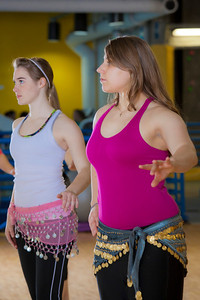 (left to right) Katheryn Zimmerman and Heather Butler  learn how to middle eastern dance in one of the recreation classes offered at the student rec center on campus.  Filename: LIF-11-3194-24.jpg