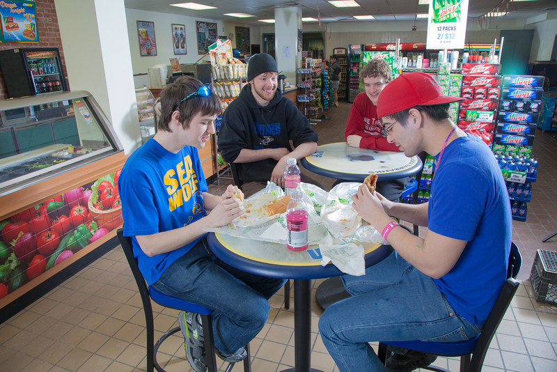 "Students Quinn Verfaillie, left, and Robert Doerning enjoy sandwiches in the Campus Cache, located in the Moore-Bartlett-Skarland residence hall complex on the Fairbanks campus.  <div class=""ss-paypal-button"">Filename: LIF-12-3339-43.jpg</div><div class=""ss-paypal-button-end"" style=""""></div>"