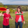"Friends Aaron Druyvestein and Serena McCormick enjoy a round of disc golf on the campus course near the University of Alaska Museum of the North.  <div class=""ss-paypal-button"">Filename: LIF-14-4191-156.jpg</div><div class=""ss-paypal-button-end"" style=""""></div>"