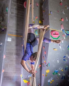 Graduate student Stephany Jeffers practices her silk climbing skills in the SRC.  Filename: LIF-13-3819-162.jpg