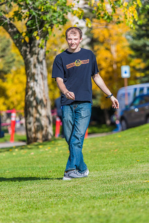 Engineering major Philip White takes time between classes to play with a frisbee on a beautiful September afternoon on the Fairbanks campus.  Filename: LIF-13-3934-105.jpg