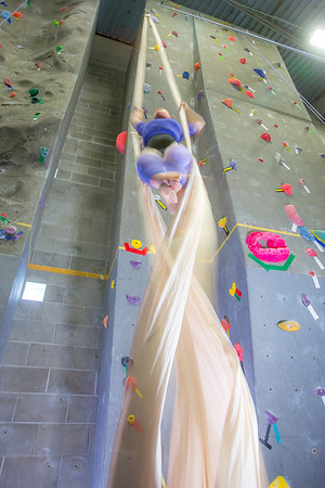 Graduate student Stephany Jeffers practices her silk climbing skills in the SRC.  Filename: LIF-13-3819-194.jpg