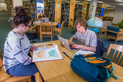 Students take advantage of the quiet area on the 5th floor of the Rasmuson Library to catch up on some studying on a recent afternoon.  Filename: LIF-14-4045-55.jpg