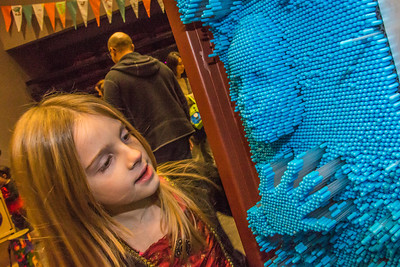 Eight-year-old Rosie Paris inspects her likeness during the Halloween party at the University of Alaska Museum of the North.  Filename: LIF-13-3988-50.jpg