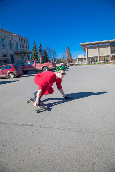 """Andrew Walsh skates around campus in his red onesie.  <div class=""""ss-paypal-button"""">Filename: LIF-12-3360-05.jpg</div><div class=""""ss-paypal-button-end"""" style=""""""""></div>"""