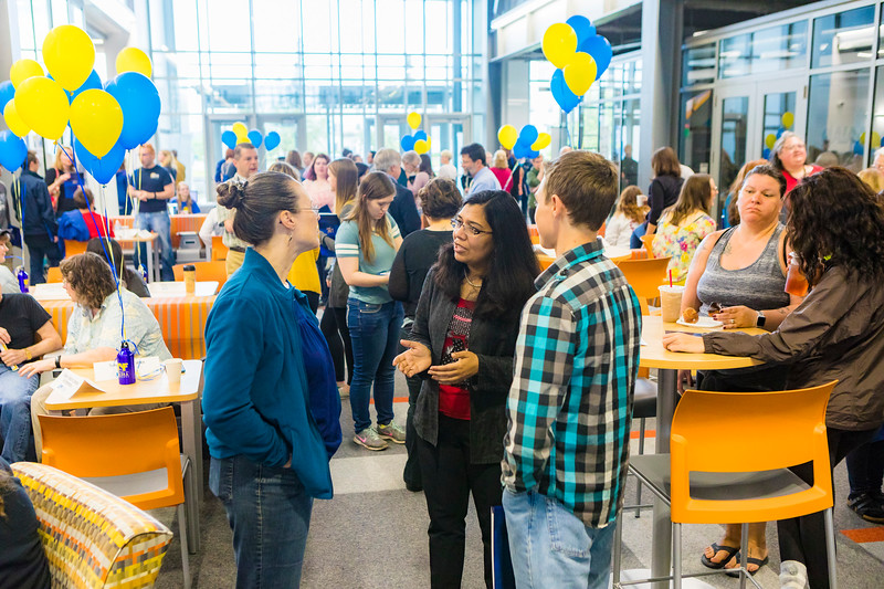 """UAF Interim College of Natural Sciences and Mathematics Dean Anupma Prakash speaks to a prospective student and a parent during the 2018 Summer Inside Out Donuts with Deans event at the Engineering Learning and Innovation Facility.  <div class=""""ss-paypal-button"""">Filename: LIF-18-5826-27.jpg</div><div class=""""ss-paypal-button-end""""></div>"""