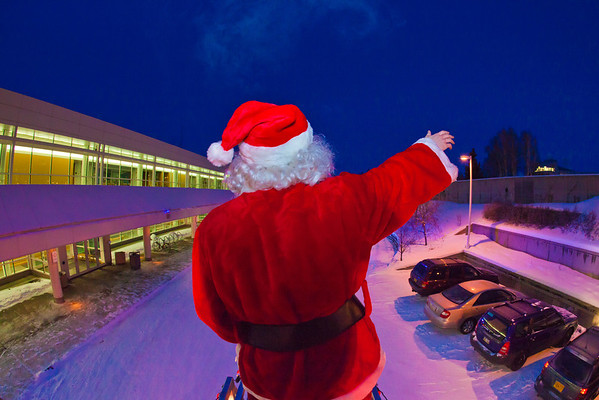"""Santa Claus made his annual rounds to various locations on the Fairbanks campus riding atop a University Fire Department truck a couple days before Christmas.  <div class=""""ss-paypal-button"""">Filename: LIF-11-3249-48.jpg</div><div class=""""ss-paypal-button-end"""" style=""""""""></div>"""