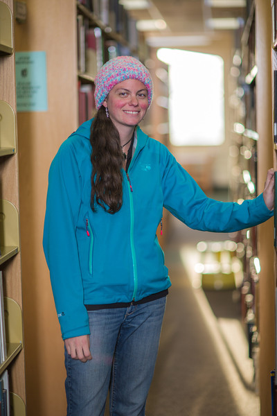 "Senior biology major Sarah Dewitt looks through the stacks on the 6th floor of the Rasmuson Library.  <div class=""ss-paypal-button"">Filename: LIF-14-4045-139.jpg</div><div class=""ss-paypal-button-end"" style=""""></div>"