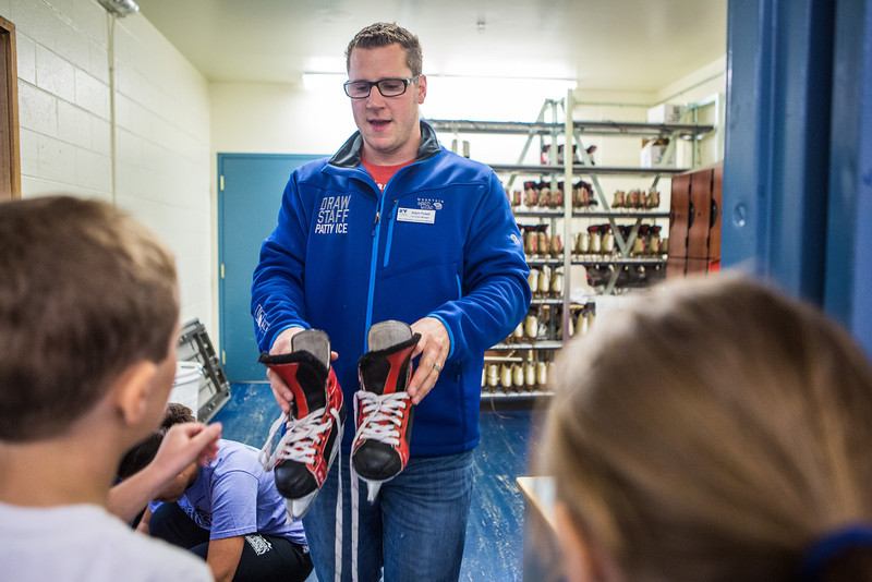 """Patty Center Ice Arena Manager, Adam Powell, hands out ice skates to children attending the SRC Summer Recreation Camp.  <div class=""""ss-paypal-button"""">Filename: LIF-13-3873-46.jpg</div><div class=""""ss-paypal-button-end"""" style=""""""""></div>"""
