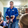 "Patty Center Ice Arena Manager, Adam Powell, hands out ice skates to children attending the SRC Summer Recreation Camp.  <div class=""ss-paypal-button"">Filename: LIF-13-3873-46.jpg</div><div class=""ss-paypal-button-end"" style=""""></div>"