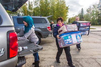 Returning students, staff and parents all pitch in to help new arrivals move into the residence halls during Rev It Up on the Fairbanks campus at the beginning of the fall 2015 semester.  Filename: LIF-15-4636-135.jpg