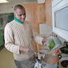 "Peter Ikewun, a petroleum engineeering graduate student from Nigeria, prepares a traditional African soup in his communal Wickersham Hall kitchen.  <div class=""ss-paypal-button"">Filename: LIF-12-3268-115.jpg</div><div class=""ss-paypal-button-end"" style=""""></div>"