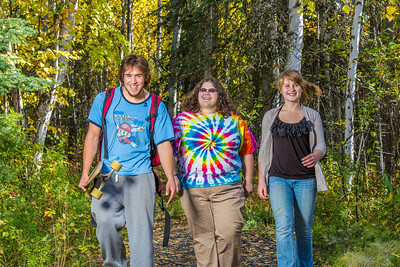 Demetri Martin-Urban, left, Grace Amundsen, center, and Kaylie Wiltersen stroll through the woods near the west entrance to campus on a nice fall afternoon.  Filename: LIF-12-3544-149.jpg