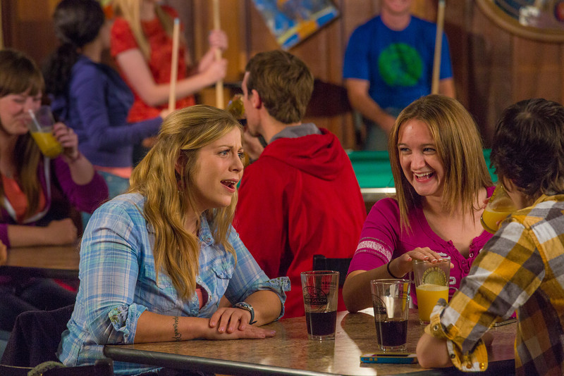 """Students unwind over a favorite beverage in the Wood Center Pub on the Fairbanks campus. (Note: Taken as part of commercial shoot with Nerland Agency -- use with discretion!)  <div class=""""ss-paypal-button"""">Filename: LIF-12-3563-099.jpg</div><div class=""""ss-paypal-button-end"""" style=""""""""></div>"""