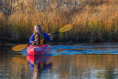 Business major Shelby Carlson enjoys a morning paddle on Ballaine Lake.  Filename: LIF-12-3562-011.jpg