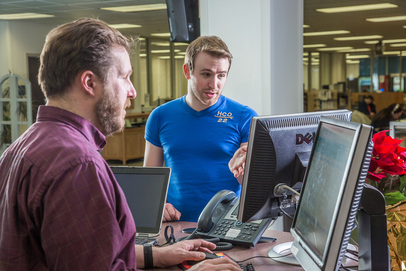"""Staff librarian Paul Adasiak, left, helps music major Campbell Longworth with a reference question in the UAF Rasmuson Library on the Fairbanks campus.  <div class=""""ss-paypal-button"""">Filename: LIF-14-4045-184.jpg</div><div class=""""ss-paypal-button-end"""" style=""""""""></div>"""