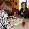 """Shehla Anjum interviews Australian UAF student May-Le Ng at the College Coffee House for an article she is writing about foreigners who chose to migrate to Alaska.  <div class=""""ss-paypal-button"""">Filename: LIF-11-3202-054.jpg</div><div class=""""ss-paypal-button-end"""" style=""""""""></div>"""