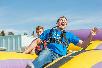 Matt Deatherage gets yanked back to the starting point during his turn in the harness pull, one of many attractions brought to campus during UAF SpringFest Field Day on April 28.  Filename: LIF-14-4168-82.jpg