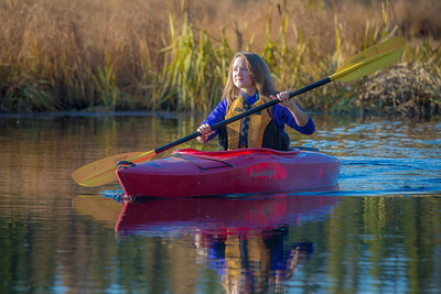 Business major Shelby Carlson enjoys a morning paddle on Ballaine Lake.  Filename: LIF-12-3562-061.jpg