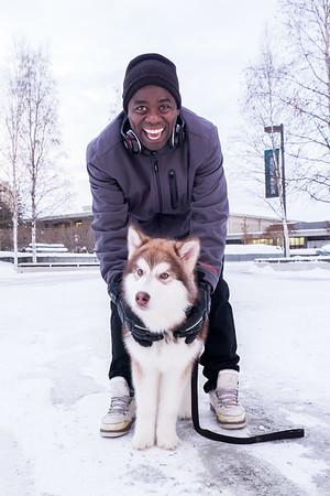 Bertrand Dushime brings his malemute to campus during winter break.  Filename: LIF-15-4424-6.jpg