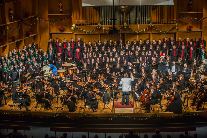"""Eduard Zilberkant conducts the Fairbanks Symphony Orchestra along with the Fairbanks Symphony Chorus and the Northland Youth Choir during the annual holiday concert in the Davis Concert Hall.  <div class=""""ss-paypal-button"""">Filename: LIF-13-4016-103.jpg</div><div class=""""ss-paypal-button-end"""" style=""""""""></div>"""