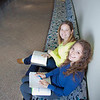 "Megan Gilmore (back) and Ashley Bartolowits (front) study in the hallway of the Syun-Ichi Akasofu building on campus.  <div class=""ss-paypal-button"">Filename: LIF-11-3242-029.jpg</div><div class=""ss-paypal-button-end"" style=""""></div>"