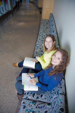 Megan Gilmore (back) and Ashley Bartolowits (front) study in the hallway of the Syun-Ichi Akasofu building on campus.  Filename: LIF-11-3242-029.jpg