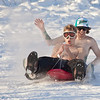 "Undergraduates Bryan Johnson, in front, and Jimmy Donohue enjoy some nice February weather between classes on the UAF sledding hill.  <div class=""ss-paypal-button"">Filename: LIF-12-3290-66.jpg</div><div class=""ss-paypal-button-end"" style=""""></div>"