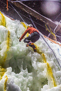 A competitor makes his way to the top of the ice wall during a climbing contest on March 1.  Filename: LIF-13-3748-204.jpg