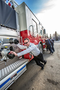 Fire Chief Doug Schrage was on hand to help others on the crew follow tradition and push the newest engine in the fleet into its place in the garage at the University Avenue station.  Filename: LIF-14-4152-33.jpg