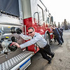 "Fire Chief Doug Schrage was on hand to help others on the crew follow tradition and push the newest engine in the fleet into its place in the garage at the University Avenue station.  <div class=""ss-paypal-button"">Filename: LIF-14-4152-33.jpg</div><div class=""ss-paypal-button-end"" style=""""></div>"