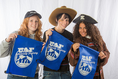 Students pose in the UAF Facebook photobooth during a back-to-school orientation party in the Wood Center.  Filename: LIF-12-3517-4.jpg